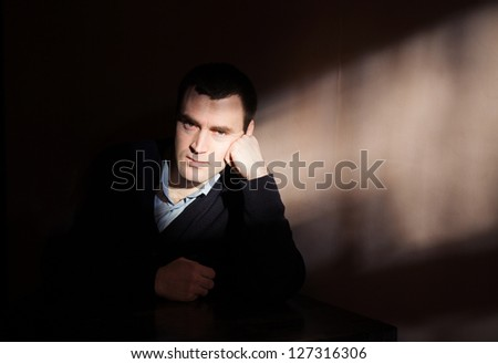 Young man suffering from a severe depression - stock photo