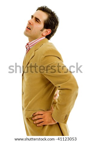 young man suffering from back pain, isolated on white - stock photo