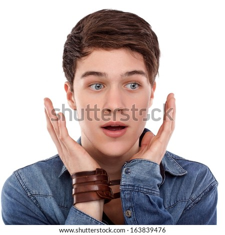 Young man surprised with open hands and mouth - stock photo