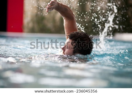 Young Man Swimming In Pool  - stock photo