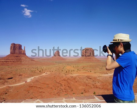 Young man taking pictures  in Monument Valley,Utah - stock photo