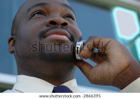 Young man talking business on his cell phone