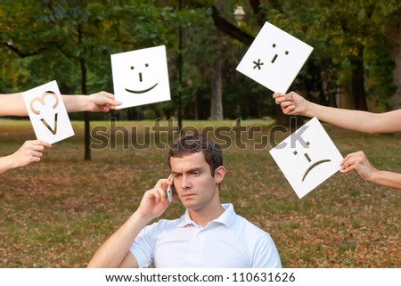 Young man talks with someone by cell phone - stock photo