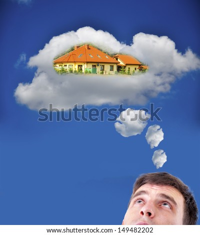 Young man thinking about new house - stock photo