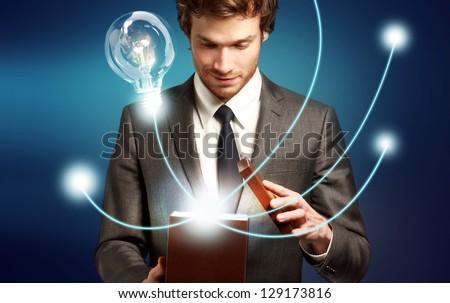 Young Man Thinking Outside the Box, Brilliant Ideas, Eureka - stock photo