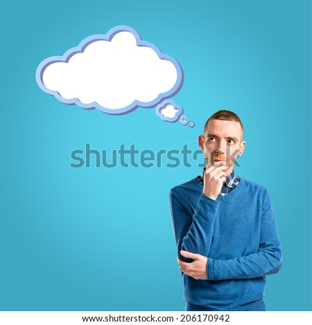 Young man thinking over blue background