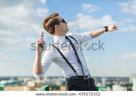 young man throwing phone - stock photo