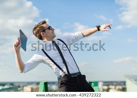 young man throws a tablet - stock photo