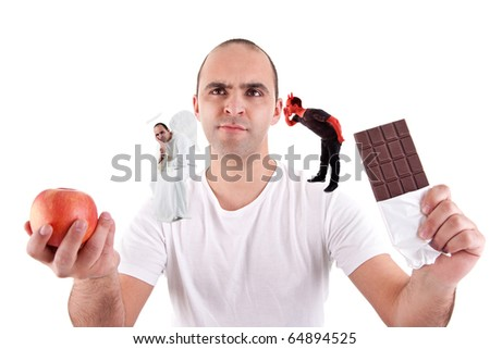 young man torn between eating an apple and a chocolate,between the devil and angel, on white - stock photo