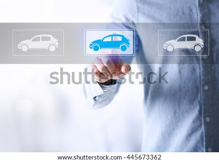 Young man touching icon of car on virtual screen