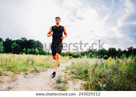 Young man training trial running