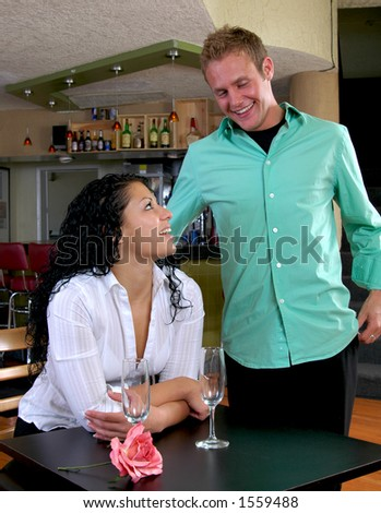 Young man trying to pick up a girl in a coffee shop
