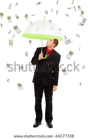 Young man under umbrella, looking up to the money rain of 100 euro banknotes - stock photo