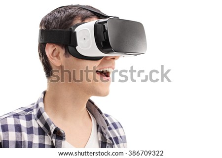 Young man using a VR headset and experiencing virtual reality isolated on white background - stock photo