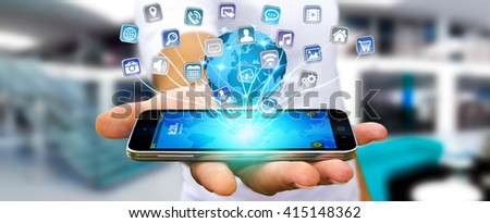 Young man using digital application with icons flying over his mobile phone