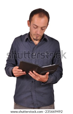 Young man using his tablet computer - stock photo