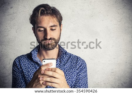 Young man using mobile phone - stock photo