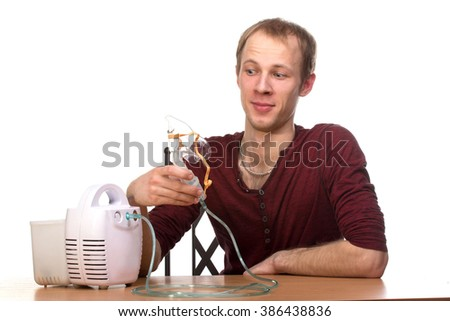 Young man using nebulizer mask for respiratory inhaler Asthma Treatment isolated on a white background