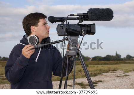 Young man videoing outside - stock photo