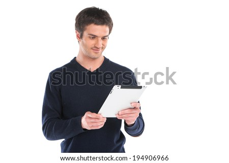 Young man waist up using tablet. handsome guy holding computer against white background - stock photo