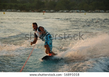 Young man wakeboarding - stock photo