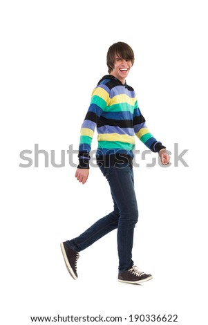 Young man walking and laughing. Full length studio shot isolated on white. - stock photo