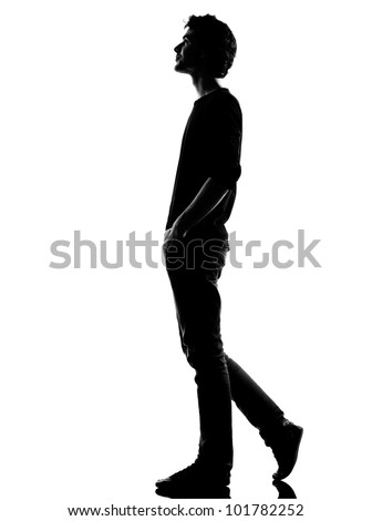 young man  walking happy smiling silhouette in studio isolated on white background - stock photo