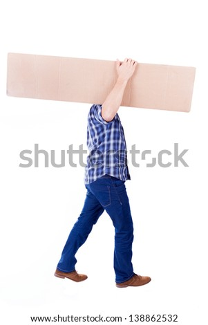 Young man walking with card box, isolated on white - stock photo