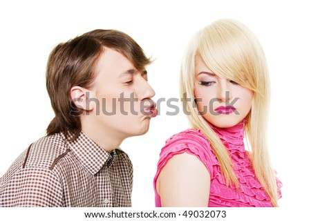 young man want to kiss inaccessible blonde. isolated on white - stock photo