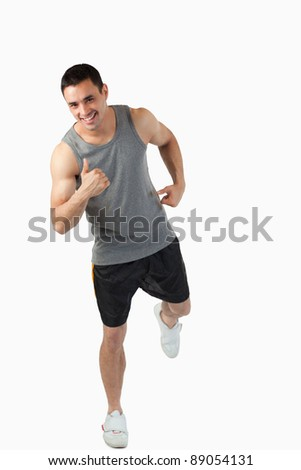 Young man warming up before workout against a white background - stock photo