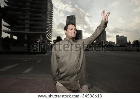 Young man waving his hand