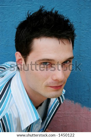 Young man wearing a striped shirt - stock photo
