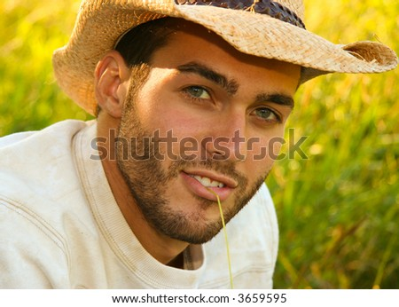 Young man wearing cowboy hat