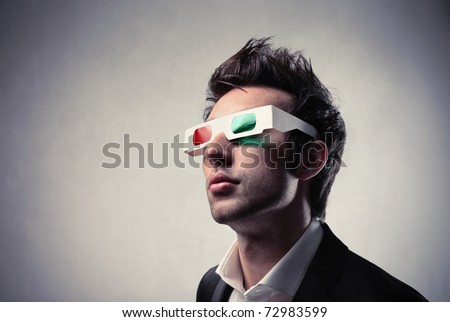Young man wearing 3d-glasses - stock photo