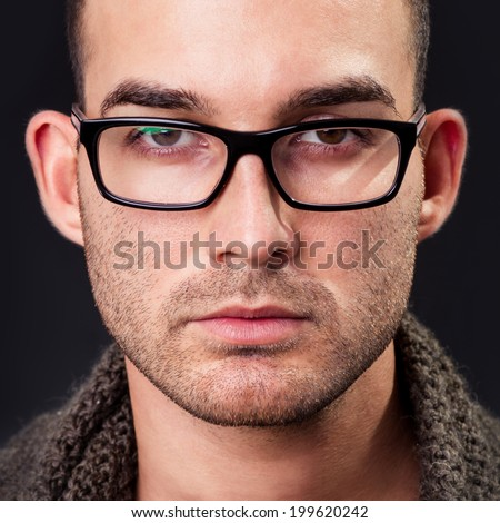young man wearing glasses, he is now a professional model - stock photo