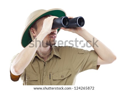 Young man wearing pith helmet looking through binoculars, isolated on white - stock photo