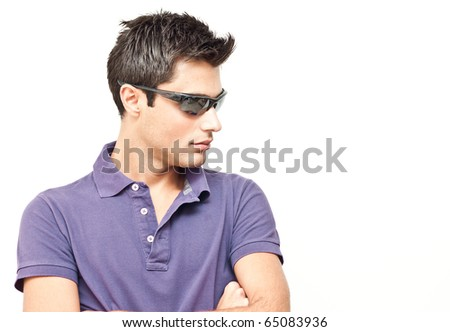 Young man wearing sunglasses - stock photo