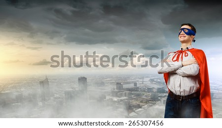 Young man wearing superman mask and cape - stock photo