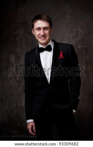 Young man wearing tuxedo. - stock photo