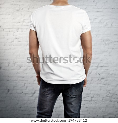 Young man wearing white t-shirt. Back. - stock photo