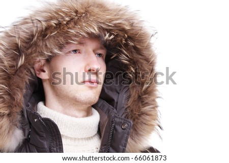 Young man wearing winter jacket isolated over white - stock photo