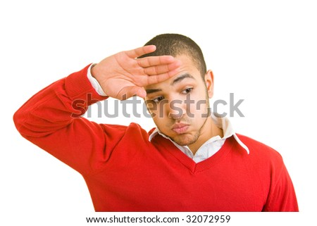 Young man wiping his forehead with his hand - stock photo