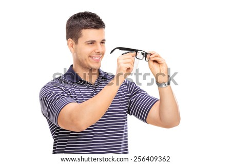 Young man wiping his glasses isolated on white background - stock photo