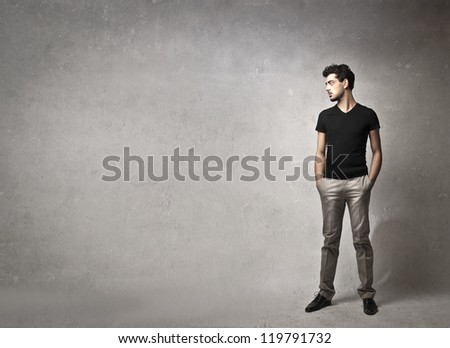 Young man with a black t-shirt posing - stock photo