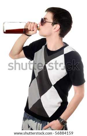 Young man with a bottle of whiskey - stock photo
