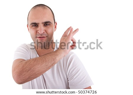 young man with a finger to remove something that is on the shoulder, isolated on white background - stock photo