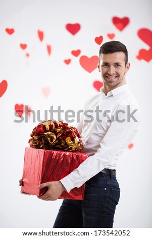 Young man with a gift - stock photo