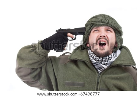 Young man with a gun on his hand, suicide concept - stock photo