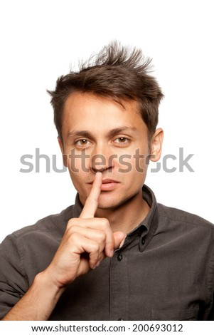 Young man with a hush gesture, isolated  - stock photo
