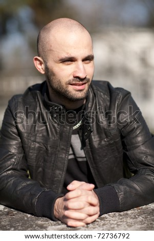 Young man with a leather jacket - stock photo